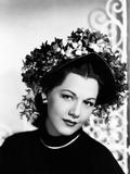 Maria Montez  Modeling a Violet-Colored Straw Bonnet Trimmed with Violets  1946