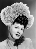 Maria Montez  Modeling a Bonnet of Grey Ostrich Feathers and Tulle  1945