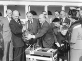 President Dwight Eisenhower Receives a Turkey from Members of the National Turkey Federation