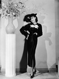 Jean Parker  Modeling a 'Collegienne Frock' of Black Satin with a Split Skirt  Ca Mid-1930s