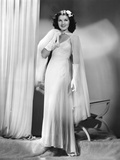 Jean Parker  Modeling a White Chiffon Evening Gown with a Rhinestone-Buckled Cape  1937