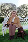 First Lady Hillary Rodham Clinton with Socks the Cat and Buddy the Dog on the White House Lawn