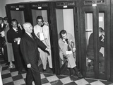 Harry Truman Walks Past Reporters in the Telephone Booths the Old State Department Building