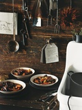 Beef Stew with Carrots and Potatoes in a Rustic Kitchen