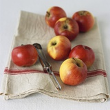 Fresh Apples on Linen Cloth with Peeler