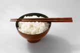 Boiled Basmati Rice in a Red Bowl with Chopsticks