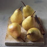Five Yellow Pears on a Chopping Board