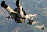 Navy Seals Jump from the Ramp of a C-17 Globemaster Iii over Virginia