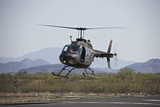 An Oh-58 Kiowa Helicopter of the US Army Landing at Pinal Airpark  Arizona