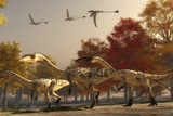 Three Eudimorphodons Fly Above a Group of Coelophysis in an Autumn Forest