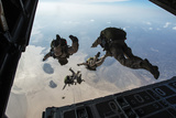 US Pararescuemen and US Marines Jump from a Hc-130 over Djibouti