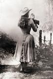 Annie Oakley Shooting over Shoulder