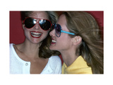 Close-Up on Two Models with Smiles  a Pair of Red Plastic Bon-Lon Sunglasses by Bonneau