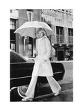 Model  Walking with an Umbrella by Givenchy