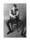 10 Years - People; Actor James Coburn  Seated Backwards on a Chair