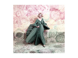 Pose Against a Mural of Swirling Roses  Model Wearing Blue Float of Peignoir in Blue Nylon Yarn