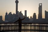 Man Doing Morning Exercises and City Skyline  Shanghai  China
