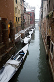 Canal with Snow on Gondolas with Bridge Sigh  Venice  Italy