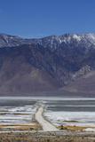 Road across Owens Lake and Sierra Nevada Mountains  California