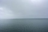 Norway. Svalbard. Hornsund. Heavy Clouds over the Calm Water Papier Photo par Inger Hogstrom