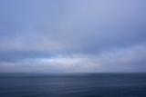Norway Svalbard Nordaustlandet Island Calm Water and Cloudy Skies