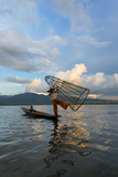 Intha Fisherman Rowing at Sunset on Inle Lake  Shan State  Myanmar