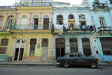 Cuba  La Havana  Old American Cars Driving Through Colonial Streets