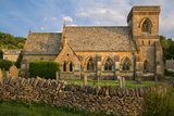 Sunset on St Barnabas Church  the Cotswolds  Gloucestershire  England