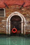 Doorway Along Canal with Safety Buoy Venice  Italy