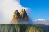Nevada  Black Rock Desert  Fly Geyser Erupting with Snowy Granite Mts