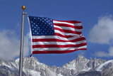 American Flag and Snow on Sierra Nevada Mountains  California  USA