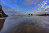 Clouds Reflect in Wet Sand at Sunrise at Bandon Beach  Bandon  Oregon