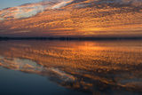 Sunrise Highlighting the Clouds Causing Dramatic Sky and Reflections
