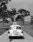 1950s Back of White Ford Sedan Driving Off with Just Married Sign