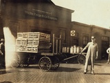 Men in Front of a Wells Fargo and Co Express Depot with Crates and Milk Cans  Missouri  1916