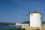 A Scenic View of the Parikia Waterfront and a Traditional Windmill