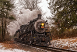 Scenic View of the Essex Steam Train Passing Through Forests in a Snow Shower