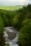 A Scenic View of a River Through a Forest  and a Rainbow from the Cabot Trail
