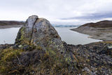 A Lichen Encrusted Boulder on a Lake Shore Carved by a Glacier