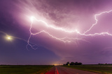 An Intense Lightning Storm over Fields and a Road in South Dakota