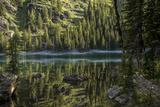 A Beautiful Alpine Lake Glows in the Morning Light  Deep in the Swan Mountain Range