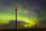 The Aurora Borealis or Northern Lights over a Wind Farm in North Dakota