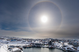 A Solar Halo  an Phenomenon Caused by Light Interacting with Ice Crystals in the Atmosphere