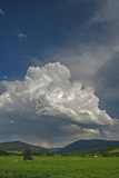A Cumulus Thunderhead Builds over Cottonwood Canyon and the Gallatin Range  Montana