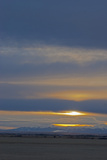 A Winter Sunset Glows over the Rocky Mountains and Gallatin Valley Near Belgrade  Montana