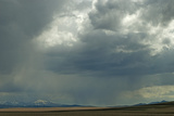 Rain Squalls Hover over Lonely Prairies  Ranchlands and Mountains North of Three Forks  Montana