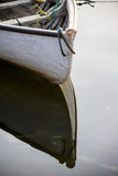 The Bow of a Dinghy Reflected on Water