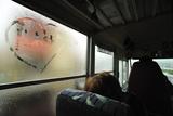 A Heart with the Word Alaska Written in It  on a Steamy Bus Window