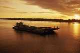 A Barge on Amazon River at Iquitos at Sunrise