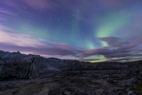 Iridescent Green Northern Lights Dance in the Sky Above Russell Glacier